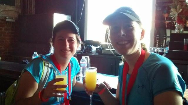 enjoying a free mimosa post-race